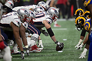 The New England Patriots offensive line gets set to snap the ball at the line of scrimmage opposite the Los Angeles Rams defensive line during the NFL Super Bowl 53 football game on Sunday, Feb. 3, 2019, in Atlanta. The Patriots defeated the Rams 13-3. (©Paul Anthony Spinelli)