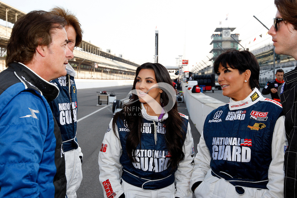 29 May 2010: Model/Actress Kim Kardashian, mother Kris Jenner, Former racecar driver Arie Luyendyk and racecar driver Arie Luyendyk, Jr.  prepare to take a couple laps around the infamous Indianapolis 500 Oval during the IZOD Two-Seat Ride Along session at the Indianapolis Motor Speedway in Speedway, IN. Corporate event photography by Infiniti Images