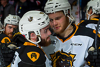REGINA, SK - MAY 25: Liam Van Loon #81 hugs Ryan Moore #40 of Hamilton Bulldogs after the loss against the Regina Pats at the Brandt Centre on May 25, 2018 in Regina, Canada. (Photo by Marissa Baecker/CHL Images)