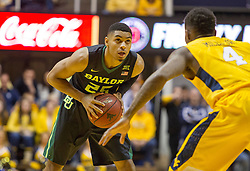 Feb 6, 2016; Morgantown, WV, USA; Baylor Bears guard Al Freeman (25) holds the ball while guarded by West Virginia Mountaineers guard Daxter Miles Jr. (4) during the first half at the WVU Coliseum. Mandatory Credit: Ben Queen-USA TODAY Sports