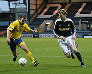Dens Park, Dundee<br /> Dundee's Kevin McDonald takes on Queen of the South's Andy Aitken