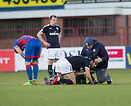 20th January 2018, Dens Park, Dundee, Scotland; Scottish Cup fourth round, Dundee versus Inverness Caledonian Thistle; Dundee's Sofien Moussa gets treatment from physio Gerry Docherty