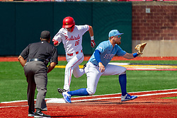 NORMAL, IL - May 01: Wayne Harris calls the play at first with Derek Parola running and Dane Tofteland covering firstbase during a college baseball game between the ISU Redbirds and the Indiana State Sycamores on May 01 2019 at Duffy Bass Field in Normal, IL. (Photo by Alan Look)