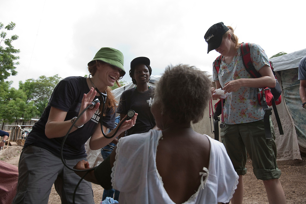 Annette Anderson, a doctor from Vancouver,working in a makeshift refugee, JP HRO, run by the movie actor Sean Penn on July 20, 2010<br /> The camp is estimated to have over 55,000 refugees.<br /> <br /> Six month after a catastrophic earthquake measuring 7.3 on the Richter scale hit Haiti on January 13, 2010, killing an estimated 230,000 people, injuring an estimated 300,000 and making homeless an estimated 1,000,000.