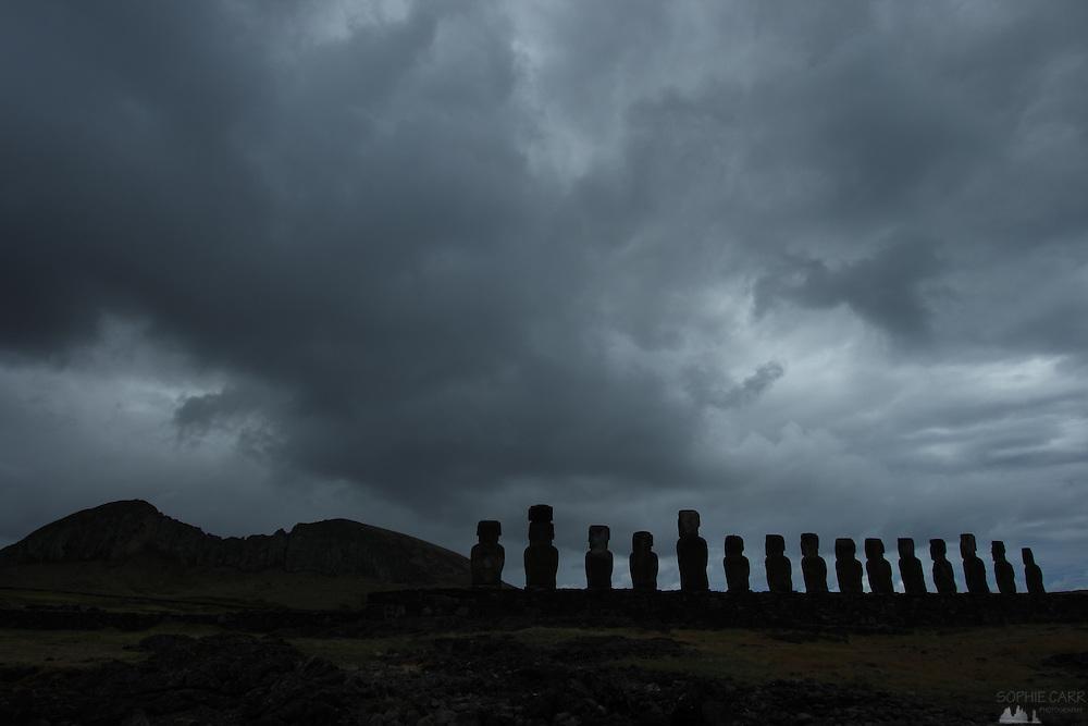 Moai at Tongariki and storm clouds over Rano Raraku volcano on Easter Island