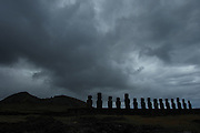Moai at Tongariki and storm clouds over Rano Raraku volcano on Easter Island