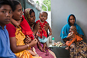Women and their children with cleft palates wait to be seen by a doctor at the IFB Chuandanga Hospital in the western region of Bangladesh.  .Impact Foundation Bangladesh (IFB) provide care, support and treatment to people with disabilities in Bangladesh.