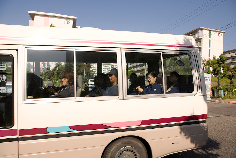 Many workers take employer provided mini buses to work every day Residents of the  Homi Danchi area of Toyota City,  Nearly all the  residents are Foreigners  with about 1/2 of them from Brazil. .. Most  work at Toyota Factories or companies  of  the Toyota Group.