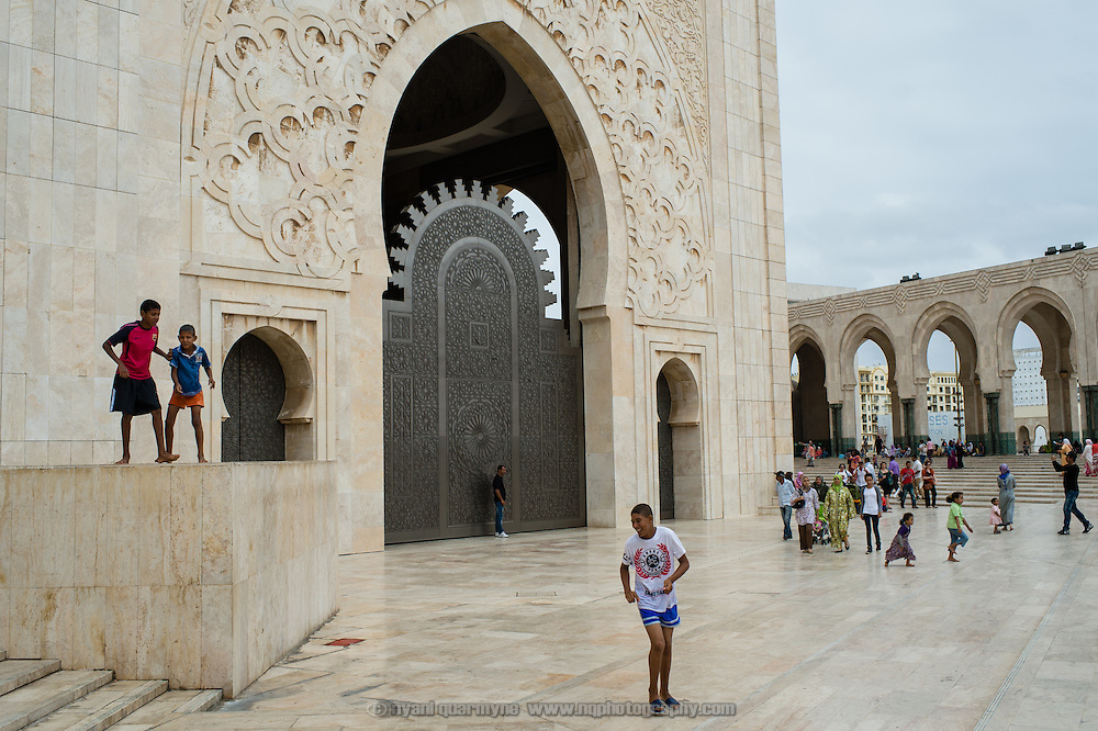 Biys playing at the Hassan II Mosque in Casablanca, Morocco on 8 September 2013. The mosque in the largest in Morocco and the seventh largest in the world, and is a popular place for families and young couples to meet.