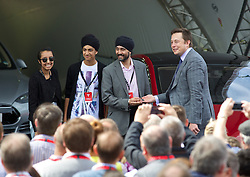 LONDON, ENGLAND - Saturday, June 7, 2014: CEO & Chief Product Architect Elon Musk hands over they keys to the UK's fifth customer of the Model S Satwinder Sian at the UK launch of Tesla Motors' Model S electric car at the Crystal. (Pic by David Rawcliffe/Propaganda)