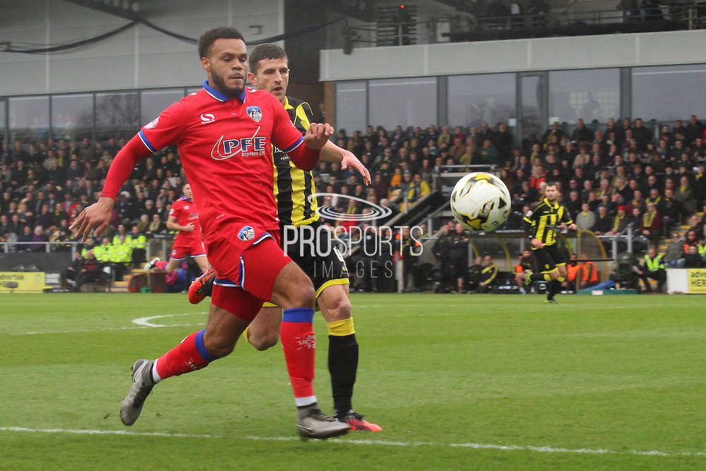 Oldham forward Aaron Holloway chases down the ball during the Sky Bet League 1 match between Burton Albion and Oldham Athletic at the Pirelli Stadium, Burton upon Trent, England on 26 March 2016. Photo by Aaron Lupton.