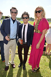 Left to right, NICK MORAN, JAMIE CULLUM and KAREN CRAIG at the St.Regis International Polo Cup at Cowdray Park, Midhurst, West Sussex on 16th May 2015.