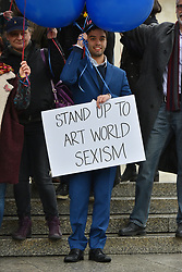 © Licensed to London News Pictures. 08/03/2017. LOndon artists stand up for gender equality in their overalls to raise awareness of gender inequality in the high-end art world. London, UK. Photo credit: Ray Tang/LNP