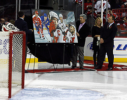 December 7, 2007; Newark, NJ, USA;  Former New Jersey Devils defenseman Scott Stevens (r) along with wife Donna, is honored by the team for his November 12, 2007 induction into the Hockey Hall of Fame before the Devils game against the Washington Capitals at the Prudential Center in Newark, NJ.
