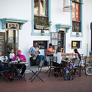 Customers sit at outdoor tables outside a cafe in Casco Viejo, the historic old quarter of Panama City.