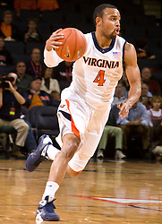 Virginia guard Calvin Baker (4) in action against Liberty. The Virginia Cavaliers fell to the Liberty Flames 86-82 in NCAA Division 1 men's basketball at the University of Virginia's John Paul Jones Arena  in Charlottesville, VA on March 9, 2008.