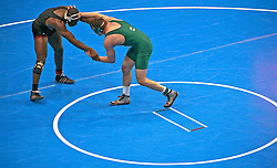 Two wrestlers face off during the NCAA Division II national championships in Cedar Rapids Iowa.