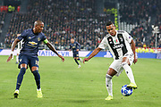 Juventus Defender Alex Sandro takes on Manchester United Midfielder Ashley Young during the Champions League Group H match between Juventus FC and Manchester United at the Allianz Stadium, Turin, Italy on 7 November 2018.