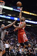 Feb 4, 2016; Phoenix, AZ, USA;  Houston Rockets forward Marcus Thornton (10) drinks the ball against Phoenix Suns center Tyson Chandler (4) at Talking Stick Resort Arena. The Rockets won 111 - 105. Mandatory Credit: Jennifer Stewart-USA TODAY Sports