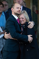 © Licensed to London News Pictures . 30/10/2018. Accrington , UK . A man hugs Gemma's mother HELEN SPROATES outside the crematorium after the service . The funeral of Gemma Nuttall at Accrington Crematorium . Gemma died of cancer despite initially seeing off the disease after radical immunotherapy treatment in Germany , paid for with the fundraising support of actress Kate Winslet , who read of Gemma's plight on a crowdfunding website shortly after she lost her own mother to cancer . Permission to photograph given by Gemma's mother , Helen Sproates . Photo credit : Joel Goodman/LNP