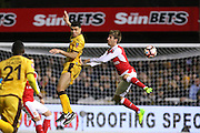 Sutton United's Maxime Biamou (24) heads the ball with Arsenal Defender Nacho Monreal during the The FA Cup match between Sutton United and Arsenal at Gander Green Lane, Sutton, United Kingdom on 20 February 2017. Photo by Phil Duncan.