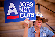 15 OCTOBER 2011 - PHOENIX, AZ:   A woman at a rally sponsored by MoveOn.org and several labor unions to press for job creation in Phoenix, AZ, Saturday. About 100 people attended the rally.  PHOTO BY JACK KURTZ