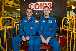 At the Baikonur Cosmodrome in Kazakhstan, Expedition 57 crewmembers Alexey Ovchinin of Roscosmos (left) and Nick Hague of NASA (right) pose for pictures in front of their Soyuz MS-10 spacecraft Sept. 26 during final pre-launch training. Ovchinin and Hague will launch Oct. 11 in the Soyuz MS-10 from the Baikonur Cosmodrome for a six-month mission on the International Space Station.<br /> <br /> NASA/Victor Zelentsov