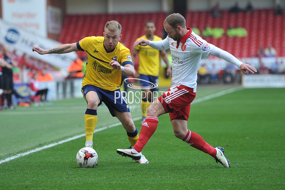 Paddy Madden of Scunthorpe United under attack from Sheffield United midfielder Matt Done (14)  during the Sky Bet League 1 match between Sheffield Utd and Scunthorpe United at Bramall Lane, Sheffield, England on 8 May 2016. Photo by Ian Lyall.