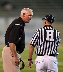 October 10, 2009; San Jose, CA, USA;  Idaho Vandals head coach Robb Akey talks to an official during the third quarter against the San Jose State Spartans at Spartan Stadium.