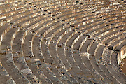 Seats of the Great Theatre, built 3rd century BC and rebuilt in the Roman period, Panayir Hill, Ephesus, Izmir, Turkey. The theatre seats 25,000 and is believed to be the largest outdoor theatre in the ancient world. The cavea has 66 rows of seats, divided by 2 diazoma or walkways into 3 horizontal sections. The stage building is 3 storeys and 18m high. The facade facing the audience was ornamented with reliefs, columns with niches, windows and statues. Ephesus was an ancient Greek city founded in the 10th century BC, and later a major Roman city, on the Ionian coast near present day Selcuk. Picture by Manuel Cohen