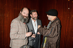 Left to right, GAVIN TURK, MATT COLLISHAW and RON ARAD at a dinner hosted by Liberatum to honour Francis Ford Coppola held at the Bulgari Hotel & Residences, 171 Knightsbridge, London on 17th November 2014.