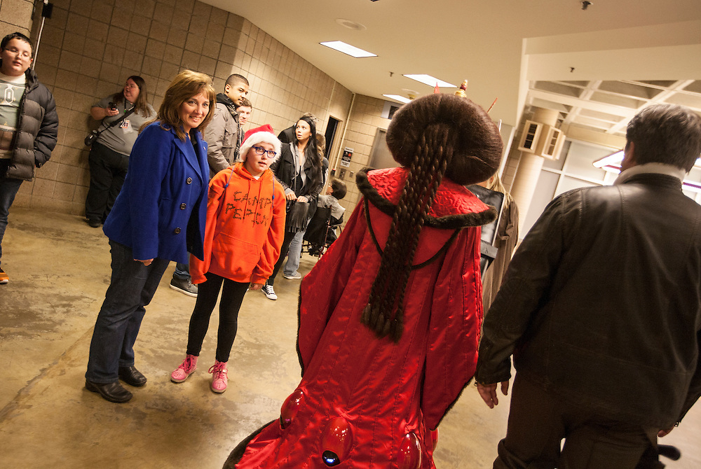 Tammy Woldt, left, and her daughter Morgan Woldt, 10, watch costumed characters walk by at Star Wars night at the Timberwolves game at Target Center in Minneapolis December 15, 2015.