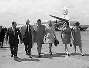 "Bob Hope, accompanied by Lady Caroline Townsend (his Press Agent in London), prepares for his whirlwind visit to Ireland as he steps from the plane at Dublin Airport. He is in Dublin to appear at the Savoy Cinema where his film ""8 on the Run"" has opened..18.05.1968"