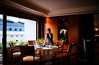 A waitress sets a table at Reflections restaurant at the Caravelle Hotel in Ho Chi Minh City, Vietnam.