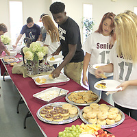 2016 SENIOR BREAKFAST<br /> (Floyd Ingram / Buy at photos.chickasawjournal.com)<br /> Houston High School 2016 Seniors, Sandy Garner, from right, Southern Bliven and Caleb Easley, enjoy breakfast cook by parents on the first day of school last week. The annual event is hosted by the HHS Parent Teacher Organization and was held at Houston First United Methodist Church Friday, Aug. 5.