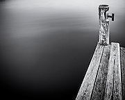 Wooden jetty at dusk, Lake Illawarra, NSW, Australia