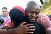 Josephus Weeks, nephew of Ebola patient Thomas Eric Duncan, hugs Barbara Johnson-Hawkins, a hospital employee, during a prayer vigil for Duncan at Texas Health Presbyterian Hospital on October 7, 2014, in Dallas. (Cooper Neill for The New York Times)