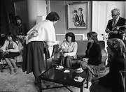 Galway Travellers Visit U.S.Embassy.    (N67)..1981..01.04.1981..04.01.1981..1st April 1981..Elizabeth,the wife of American Ambassador Mr William Shannon,invited a group of Galway travellers to afternoon tea at the residence in Phoenix Park, Dublin..Mrs Shannon,still wearing the Galway shawl, is photographed offering tea to her guests.