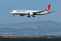 Boeing 777-3F2(ER) (TC-LJB) operated by Turkish Airlines landing at San Francisco International Airport (KSFO), San Francisco, California, United States of America
