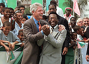 US President Bill Clinton(L) hugs Brazilian soccer legend Pele(R) 15 October during a visit to the Mangueira School in the favela (shantytown) of the same name in Rio de Janeiro. Clinton and Pele played soccer following Clinton's address to the school's students. Clinton is concluding a three-day  official visit to Brazil as part of a three-country Latin American tour.  (ELECTRONIC IMAGE)  AFP PHOTO/Bob PEARSON