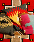 0108-1037 ~ Copyright: George H. H. Huey ~ Historic Navajo blanket pillows in the Hubbell Home. Hubbell Trading Post founded 1878. Hubbell Trading Post National Historic Site, Arizona.