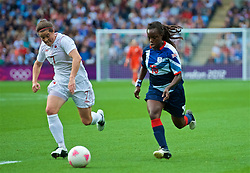 COVENTRY, ENGLAND - Friday, August 3, 2012: Great Britain's Eniola Aluko (R) and Canada's Rhian Wilkinson during the Women's Football Quarter-Final match between Great Britain and Canada, on Day 7 of the London 2012 Olympic Games at the Rioch Arena. Canada won 2-0. (Photo by David Rawcliffe/Propaganda)