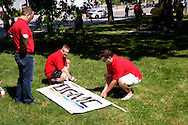 (from left) Nathan Webber of Kettering, David Moyer of Springboro and Brian Tombow of Dayton get the banner for the Dayton Gay Men's Chorus ready for the annual Dayton Pride Parade and Festival in downtown Dayton, Saturday, June 2, 2012.