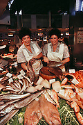 Twin fishmongers in the Mercado del Ninot, Barcelona, Spain.