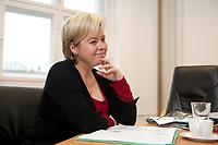 04 NOV 2010, BERLIN/GERMANY:<br /> Gesine Loetzsch, Die Linke, Parteivorsitzende, waehrend einem Interview, in Ihrem Buero, Karl-Liebknecht-Haus<br /> IMAGE: 20101104-01-031<br /> KEYWORDS: Gesine Lötzsch