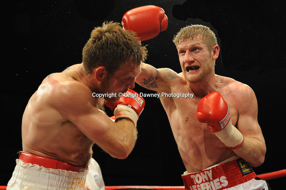 Tony Jeffries (red/white shorts) defeats Nathan King at Coventry Skydome, Coventry, United Kingdom on 23rd April 2010. Frank Maloney Promotions.Photo credit: © Leigh Dawney