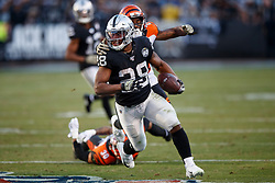 OAKLAND, CA - NOVEMBER 17: Running back Josh Jacobs #28 of the Oakland Raiders rushes up field against the Cincinnati Bengals during the fourth quarter at RingCentral Coliseum on November 17, 2019 in Oakland, California. The Oakland Raiders defeated the Cincinnati Bengals 17-10. (Photo by Jason O. Watson/Getty Images) *** Local Caption *** Josh Jacobs