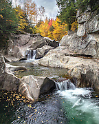 Fall foliage provided the perfect backdrop for these beautifully sculpted rocks and waterfalls.