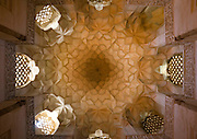 Stunning photographs reveal the beautiful ceilings in Iran's mosques, bazaars and public baths<br /> <br /> For the past few decades, restrictions on travel to Iran has meant the country has been largely shut off from the Western world, but as visa sanctions are lifted in the light of a landmark nuclear deal, the local tourism industry is hoping for a flurry of visitors.<br /> It's not hard to see why Iran is listed as one of the top travel destinations of 2016, with its rich culture and history. <br /> Among the standout aspects of the nation is its beautiful ancient architecture, with the cities and towns littered with ornate and eye-catching mosques, public baths and markets. <br /> And unlike many other countries - the roof is not an afterthought, with many ceilings built as the centrepiece to the building, with many of the tile designs showcasing a display of intricate geometric patterns that date back several centuries. <br /> French photographer Eric Lafforgue has travelled the country photographing the ceilings of indoor markets, mosques and bath houses. <br /> <br /> Photo shows: The ceiling in Jameh Mosque, Natanz. The mosque is one of the best-preserved of all Ilkhanid-era buildings