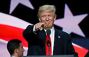 Republican presidential nominee Donald Trump points at the gathered media during his walk through at the Republican National Convention in Cleveland July 21, 2016.  REUTERS/Rick Wilking